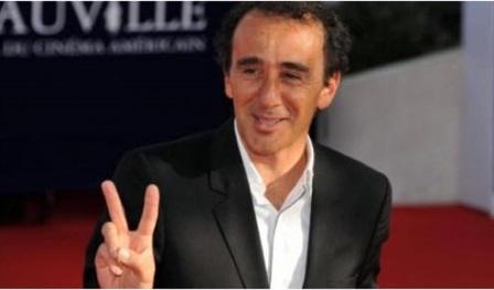 Elie Semoun V de victoire logo site officiel des journalistes